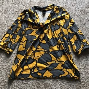 Really cool looking top. Size L. Cozy and cute.